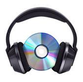 CD in black wireless stereo headphones — Stock Photo