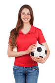Cute girl holding a soccer ball — Stock Photo