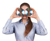 Woman holds two CDs in front of his face — Stock fotografie