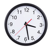 Office clock shows half of the fourth — Stock Photo
