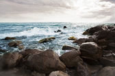 Stones on the beach washed by waves — Stock Photo