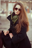 Beautiful woman in an elegant black coat — Stock Photo