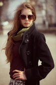 Stylish girl with long hair wearing sunglasses — Stock Photo
