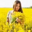 Stock Photo: Girl holding bouquet of yellow flowers