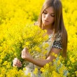 Stock Photo: Beautiful girl with bouquet in field