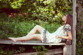 Girl in a summer dress lying and relaxing — Stock Photo