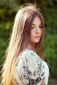 Beautiful long-haired girl — Stock Photo