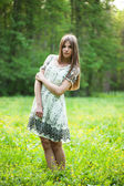 Girl stands in the middle of a lawn — Stock Photo