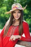 Girl in a red dress and hat — Stock Photo