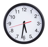 Office round clock shows half past five — 图库照片