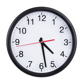 Office clock shows half past four — Stock Photo