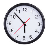Large clock shows five to six — Stock Photo