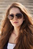 Beautiful young woman in stylish sunglasses — Stock Photo