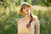 Happy girl in a straw hat — Stock Photo