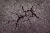 Asphalt with cracks on the surface — Stock Photo