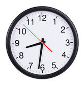 Office clock shows half of the ninth — Photo