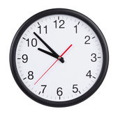Office clock shows five to ten — Stock Photo