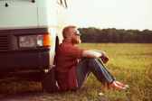 Driver sits next to his car — Stock Photo
