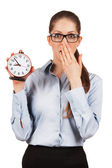 Young woman with an alarm clock in a hand — Foto de Stock
