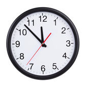 At five to twelve o'clock on the dial clock — Stock Photo