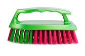 Plastic clothes brush with multicolored bristles — Stock Photo