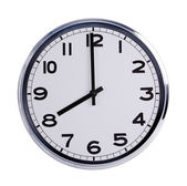 Round office clock shows eight o'clock — Stock Photo