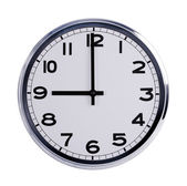 Round office clock shows nine o'clock — Stock Photo