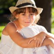 Stock Photo: Merry brown-eyed girl in stylish hat