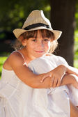 Merry brown-eyed girl in a stylish hat — Stock Photo