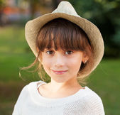 Charming brown-eyed girl in stylish hat — Stock Photo
