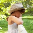 Sad little girl in a hat — Stock Photo