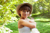 Cheerful smiling girl in a hat — Stock Photo