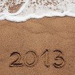 Figure in 2013 was written on the sea sand — Stock Photo