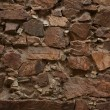Stock Photo: Ancient wall built of uncut bricks