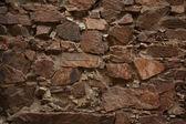 Ancient wall built of uncut bricks — Stock Photo
