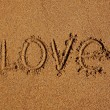 Word love written on the sand  — Foto Stock