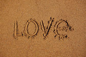 Word love written on the sand — Stock Photo