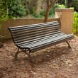Old wooden bench in the park — Stock Photo