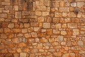 Old brick wall of rough stone — Foto Stock