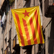 Flag of Catalonia posted on the city street — Stock Photo