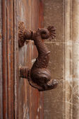 Old doorhandle in the form of a fish — Stock Photo