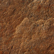Uneven surface of brown stone — Stock Photo