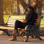 Young sad woman sitting alone — Stock Photo #35436383