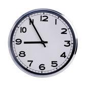 Office clock shows five to nine — Stock fotografie