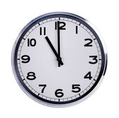 Round office clock shows eleven o'clock — Stockfoto