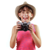 Cheerful girl with a camera — Stock Photo