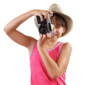 Little girl photographs old camera — Stock Photo