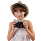 Cute girl with a film camera — Stock Photo
