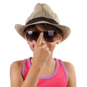 Little girl in a straw hat and sunglasses — Stock Photo