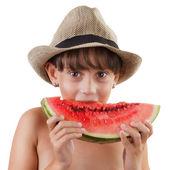 Pretty brown-eyed girl eating ripe watermelon — Stock Photo